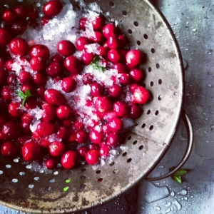 colander of cranberries on ice