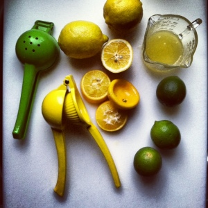 citrus press with limes and lemons
